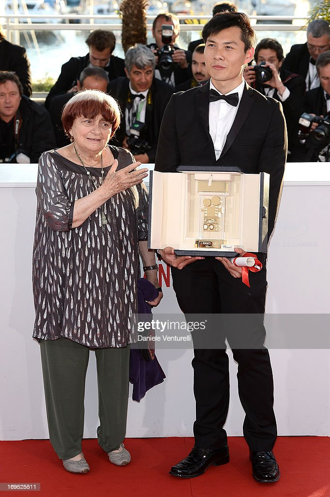 President of the Camera d'Or jury Agnes Varda and director Anthony Chen pose after receiving the Camera d'Or for 'Ilo Ilo' at the photocall for award winners during the 66th Annual Cannes Film Festival at Palais des Festivals on May 26, 2013 in Cannes, France.