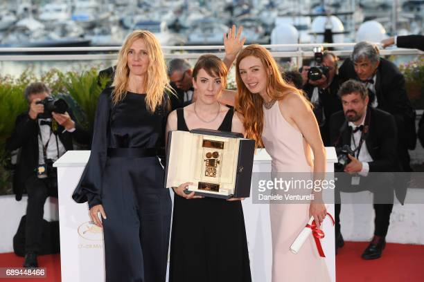 President of the Camera d'Or jury Sandrine Kiberlain and actress Laetitia Dosch poses with director Leonor Serraille winner of the Camera d'Or for...