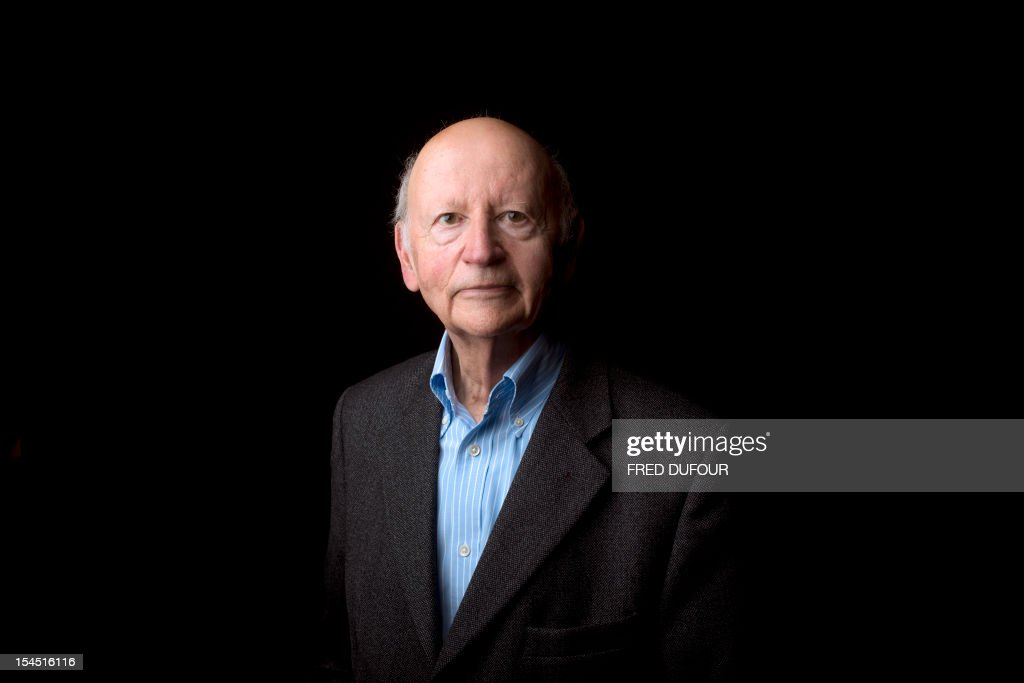 President of the Cannes International Film Festival Gilles Jacob poses on October 21, 2012 in Paris, during the Cite de la Reussite. AFP PHOTO / FRED DUFOUR