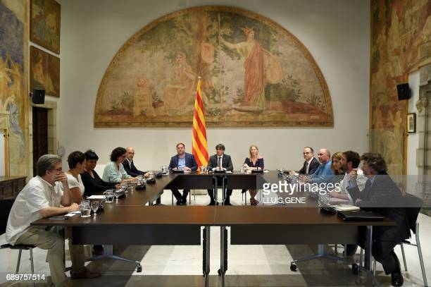 President of the Catalan government Carles Puigdemont poses before a meeting on May 29 2017 in Barcelona with representatives of the political...