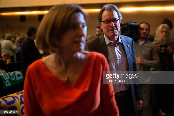 President of the Catalan parliament Carme Forcadell and former President of the Catalan government Artur Mas arrive to attend a political rally...