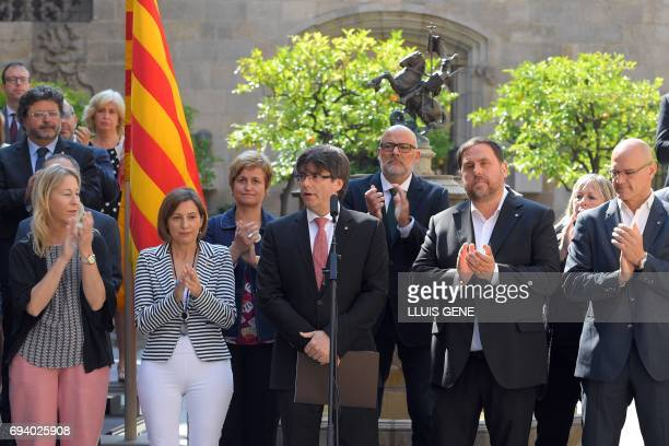 President of the Catalan regional government Carles Puigdemont speaks flanked by president of the Catalan parliament Carme Forcadell and Catalan...