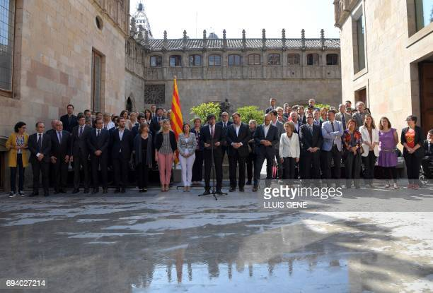 President of the Catalan regional government Carles Puigdemont speaks flanked by president of the Catalan parliament Carme Forcadell Catalan regional...