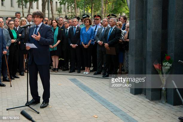 President of the Catalan regional government Carles Puigdemont speaks beside Mayor of Barcelona Ada Colau President of the Basque regional government...