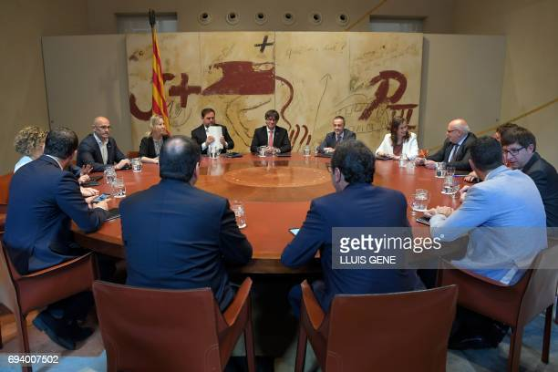 President of the Catalan reional government Carles Puigdemont attends a meeting with his cabinet's members prior to publicly announcing the date to...