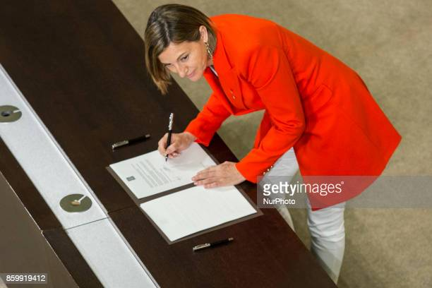 President of the Catalonia Parliament Carme Forcadell signs the proposal for declaration of independence In Barcelona on October 10 of 2017