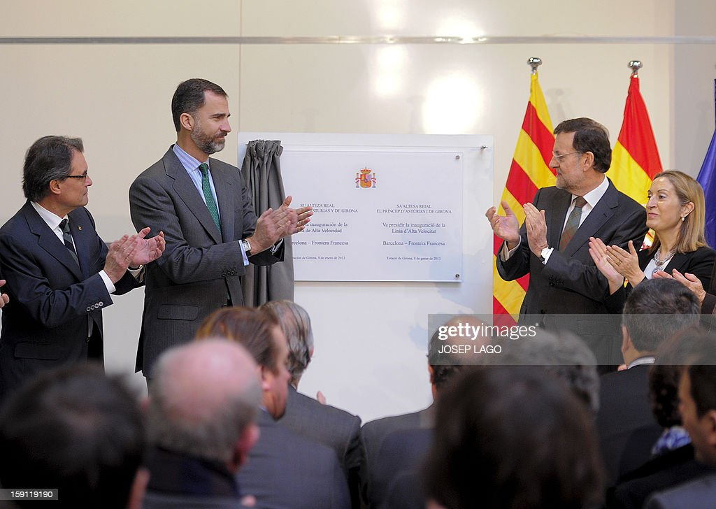 President of the Catalonia regional government and leader of the Catalan party CIU (Convergence and Unity party) Artur Mas, Spain's Prince Felipe, Spanish Prime Minister and PP (Popular Party) leader Mariano Rajoy and Spain's Minister of Development Ana Pastor applaud during the inauguration of the high-speed line between Barcelona and the french border, at Girona train station on January 8, 2013.