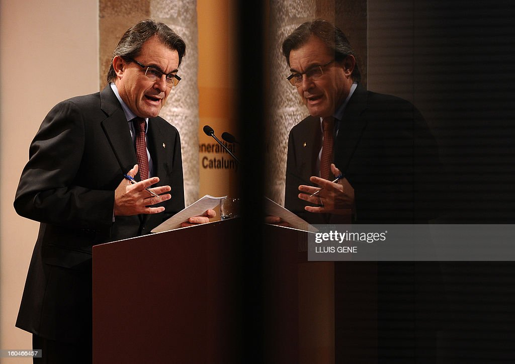 President of the Catalonia regional government and leader of the Catalan party CIU (Convergence and Unity party) Artur Mas, reflected in a window, gives a press conference in Barcelona on February 1, 2013.