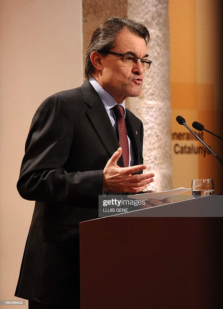 President of the Catalonia regional government and leader of the Catalan party CIU (Convergence and Unity party) Artur Mas gestures as he gives a press conference in Barcelona on February 1, 2013.