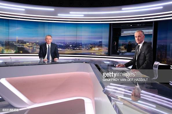 President of the centerright Modem party Francois Bayrou poses next to French journalist Gilles Bouleau prior to a broadcast interview on a set of...