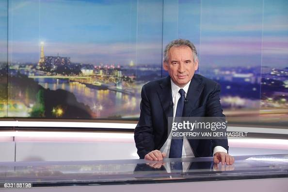 President of the centerright Modem party Francois Bayrou poses prior to a broadcast interview on a set of French TV channel TF1 on January 31 2017 in...