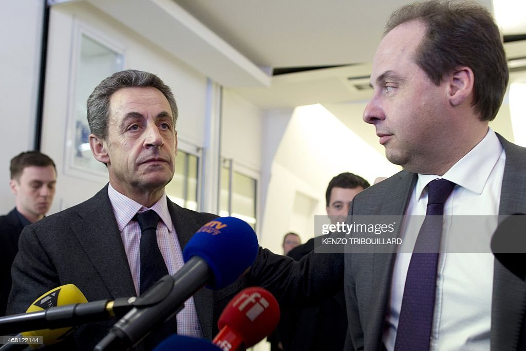 President of the center-right party UDI <a gi-track='captionPersonalityLinkClicked' href=/galleries/search?phrase=Jean-Christophe+Lagarde&family=editorial&specificpeople=7499467 ng-click='$event.stopPropagation()'>Jean-Christophe Lagarde</a> (R) and UMP right-wing party president <a gi-track='captionPersonalityLinkClicked' href=/galleries/search?phrase=Nicolas+Sarkozy&family=editorial&specificpeople=211375 ng-click='$event.stopPropagation()'>Nicolas Sarkozy</a> talk to the press after a meeting at the UMP headquarters in Paris on March 30, 2015.