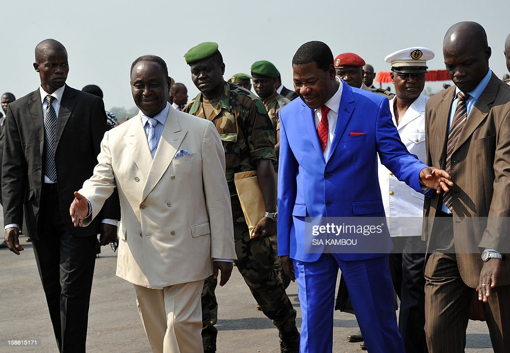 President of the Central African Republic Francois Bozize (2nd L) greets the current president of the African Union and President of Benin Yayi Boni (3rd R) at the airport in Bangui, on December 30, 2012. Rebels in the Central African Republic who have advanced towards the capital Bangui warned they could enter the city even as the head of the African Union prepared to launch peace negotiations. Central African President Francois Bozize also stated today he was open to a national unity government after talks with rebel leaders and that he would not run for president in 2016. AFP PHOTO/ SIA KAMBOU