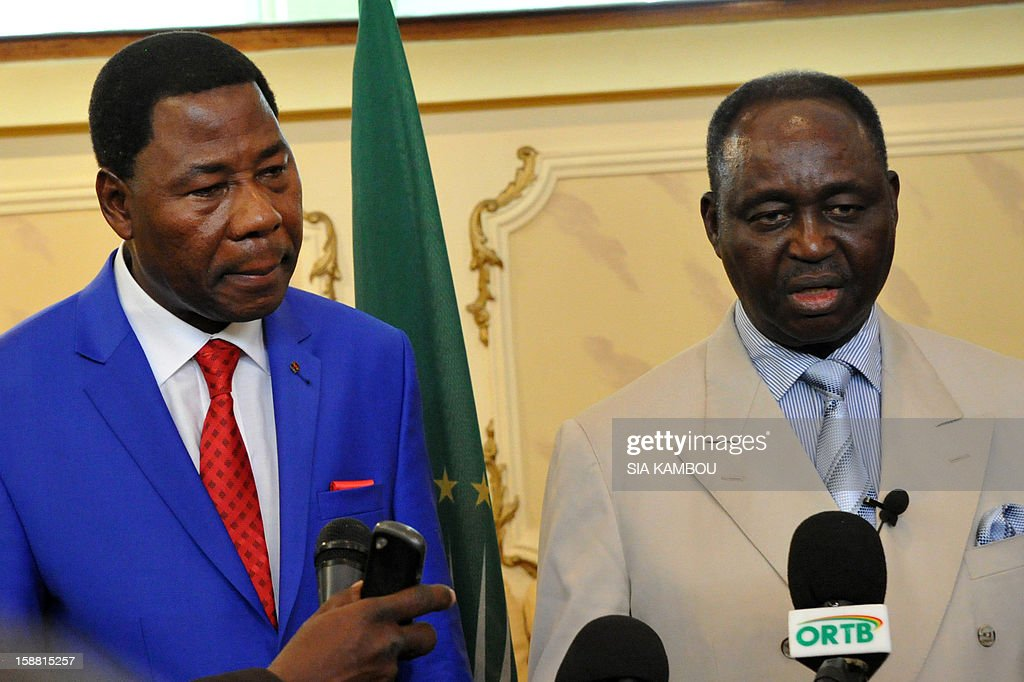 President of the Central African Republic Francois Bozize (R) speaks during a joint press conference with the current president of the African Union and President of Benin Yayi Boni at the airport in Bangui, on December 30, 2012. Rebels in the Central African Republic who have advanced towards the capital Bangui warned they could enter the city even as the head of the African Union prepared to launch peace negotiations. Central African President Francois Bozize also stated today he was open to a national unity government after talks with rebel leaders and that he would not run for president in 2016. AFP PHOTO/ SIA KAMBOU