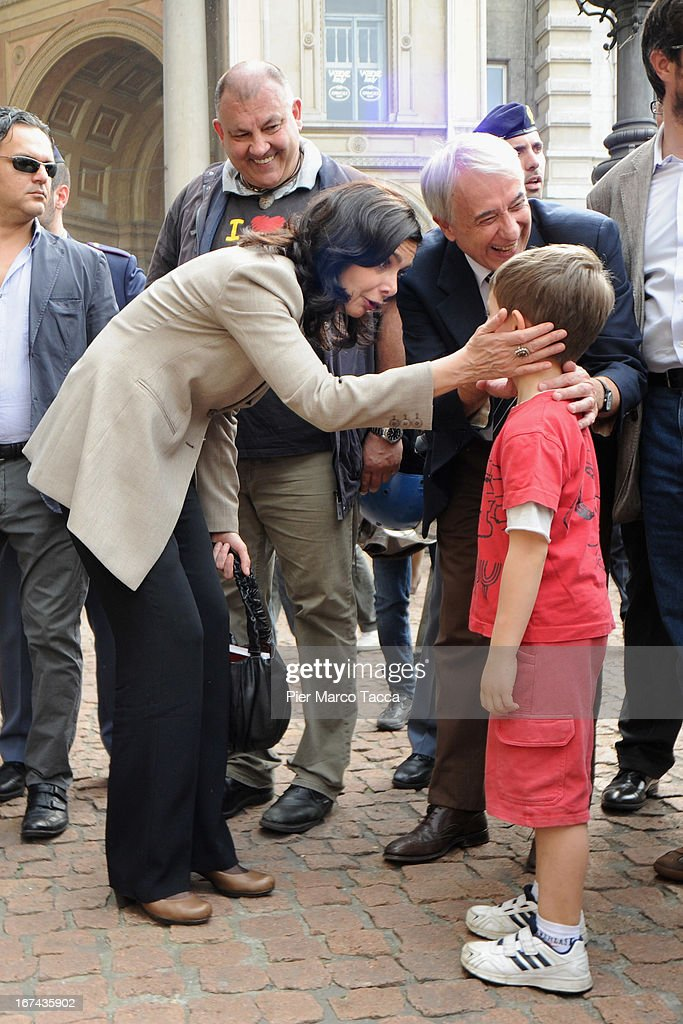 President of the Chamber of Deputies Laura Boldrini and Mayor of Milan Giuliano Pisapia speak with a child during celebrations to mark the 68th Festa della Liberazione on April 25, 2013 in Milan, Italy.The symbolic celebration day commemorates the Liberation of Italy and the Italian resistance movement after the Nazi occupation army left Northern Italy on April 25, 1945.