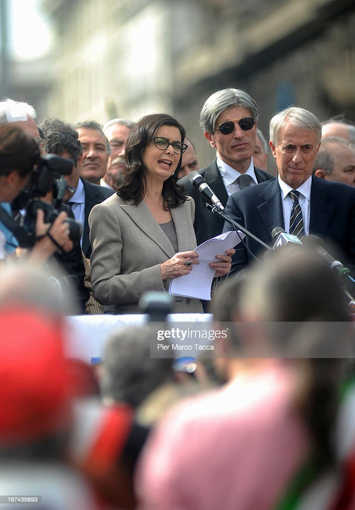 President of the Chamber of Deputies Laura Boldrini makes a speech in Duomo square as Mayor of Milan Giuliano Pisapia looks on, during celebrations to mark the 68th Festa Della Liberazione on April 25, 2013 in Milan, Italy.The symbolic celebration day commemorates the Liberation of Italy and the Italian resistance movement after the Nazi occupation army left Northern Italy on April 25, 1945.