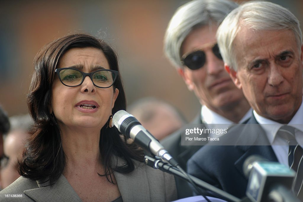 President of the Chamber of Deputies Laura Boldrini makes a speech in Duomo square during celebrations to mark the 68th Festa della Liberazione and Mayor of Milan Giuliano Pisapia on April 25, 2013 in Milan, Italy.The symbolic celebration day commemorates the Liberation of Italy and the Italian resistance movement after the Nazi occupation army left Northern Italy on April 25, 1945.
