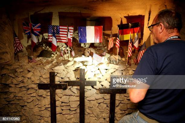 President of the Chemin des Dames Association Gilles Chauwin stands in front of an altar in a cave successively occupied by French and German...