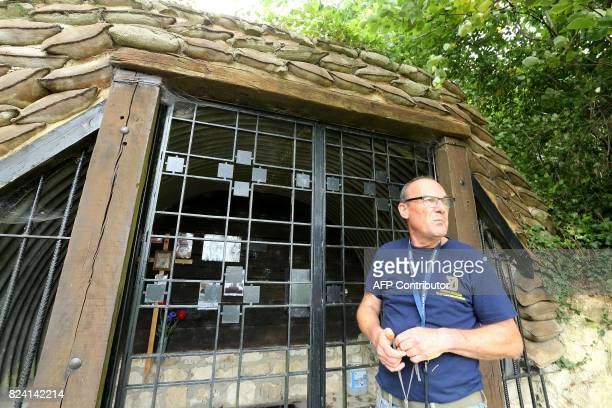 President of the Chemin des Dames Association Gilles Chauwin stands at the entrance of a cave successively occupied by French and German soldiers...