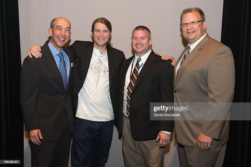 President of the Chicago chapter of the Recording Academy Matt Hennessy and faculty members of Neuqua Valley High School attend the GRAMMY Signature School Presentation. Neuqua Valley High School was honored as a National GRAMMY Signature School and received an award of $10,000 at Neuqua Valley High School on May 7, 2013 in Naperville, Illinois.