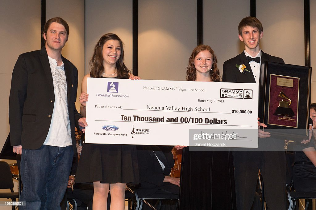 President of the Chicago chapter of the Recording Academy Matt Hennessy and students Caroline Brown, Mary Beth McMullan and Corey Worley attend the GRAMMY Signature School Presentation. Neuqua Valley High School was honored as a National GRAMMY Signature School and received an award of $10,000 at Neuqua Valley High School on May 7, 2013 in Naperville, Illinois.