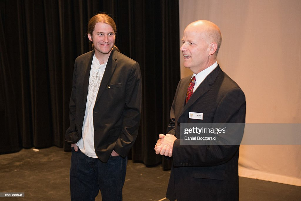 President of the Chicago chapter of the Recording Academy Matt Hennessy and fine arts department chair Charles Staley attend the GRAMMY Signature School Presentation. Neuqua Valley High School was honored as a National GRAMMY Signature School and received an award of $10,000 at Neuqua Valley High School on May 7, 2013 in Naperville, Illinois.