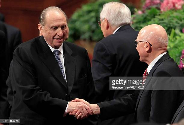 President of the Church of Jesus Christ of Latter Day Saints Thomas Monson greets fellow Mormon Apostle Dallin Oaks after the first session of the...