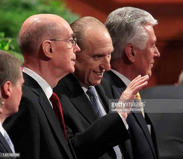 President of the Church of Jesus Christ of Latter Day Saints Thomas Monson waves to the faithful along with his first counselor Henry Eyring and his...