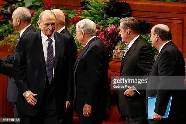 President of the Church of Jesus Christ of LatterDay Saints Thomas Monson walks past other Mormon Apostles as he leaves the Conference Center after...
