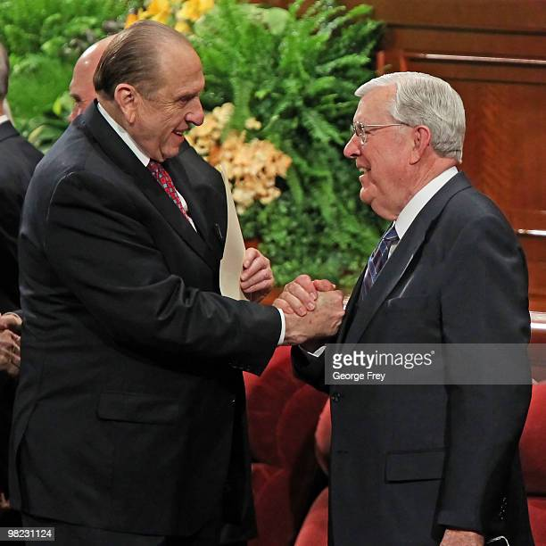 President of the Church of Jesus Christ of LatterDay Saints Thomas Monson shakes the hands of Mormon Quorum of the Twelve Apostle Russell Ballard...