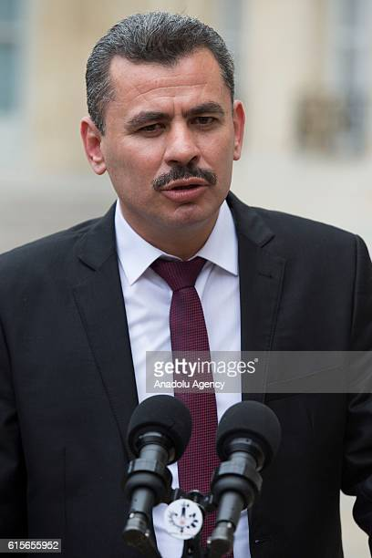 President of the civil committee of Aleppo Hagi Hasan Brita speaks to press members after the meeting with French President Francois Hollande and...
