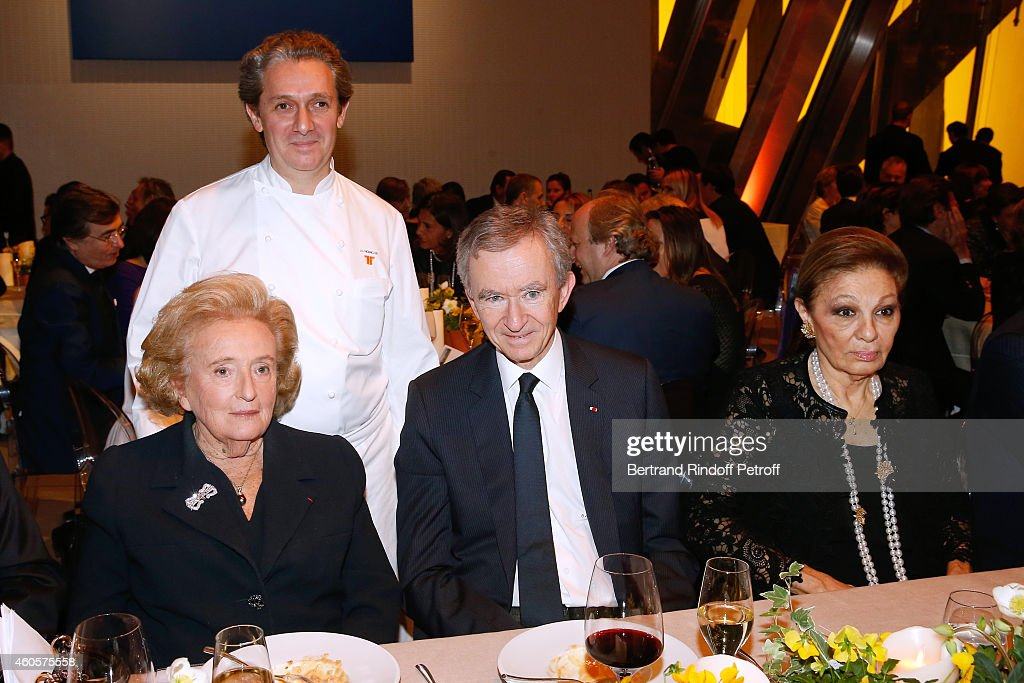 President of the 'Claude Pompidou Foundation' Bernadette Chirac, Chef Jean-Louis Nomicos, Owner of LVMH Luxury Group Bernard Arnault and HIH Empress Farah Pahlavi attend the 'Fondation Claude Pompidou' : Charity Party at Fondation Louis Vuitton on December 16, 2014 in Paris, France.