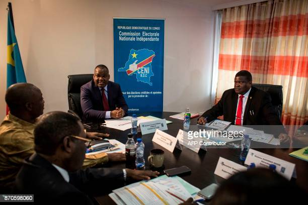 President of the Commission Electorale Nationale Independante Corneille Nangaa meets with his ministers on November 5 2017 in Kinshasa during an...