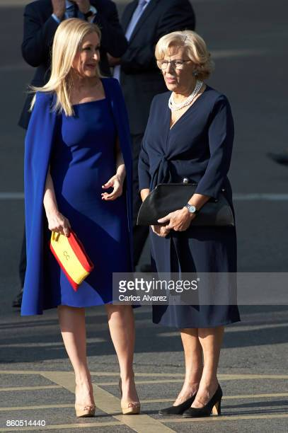 President of the Community of Madrid Cristina Cifuentes and Mayor of Madrid Manuela Carmena attend the National Day Military Parade 2017 on October...