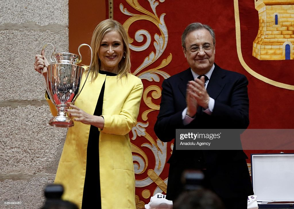President of the Community of Madrid Cristina Cifuentes (L) and President of Real Madrid Florentino Perez pose with trophy (R) during their visit to President of the Community of Madrid Cristina Cifuentes after Real Madrid won the UEFA Champions League Final match against Club Atletico de Madrid, at Madrid City Hall in Madrid, Spain on May 29, 2016.