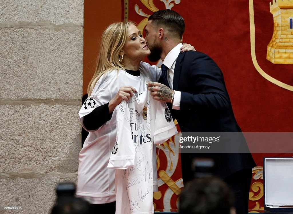 President of the Community of Madrid Cristina Cifuentes (L) is seen with Sergio Ramos during their visit to President of the Community of Madrid Cristina Cifuentes after Real Madrid won the UEFA Champions League Final match against Club Atletico de Madrid, at Madrid City Hall in Madrid, Spain on May 29, 2016.