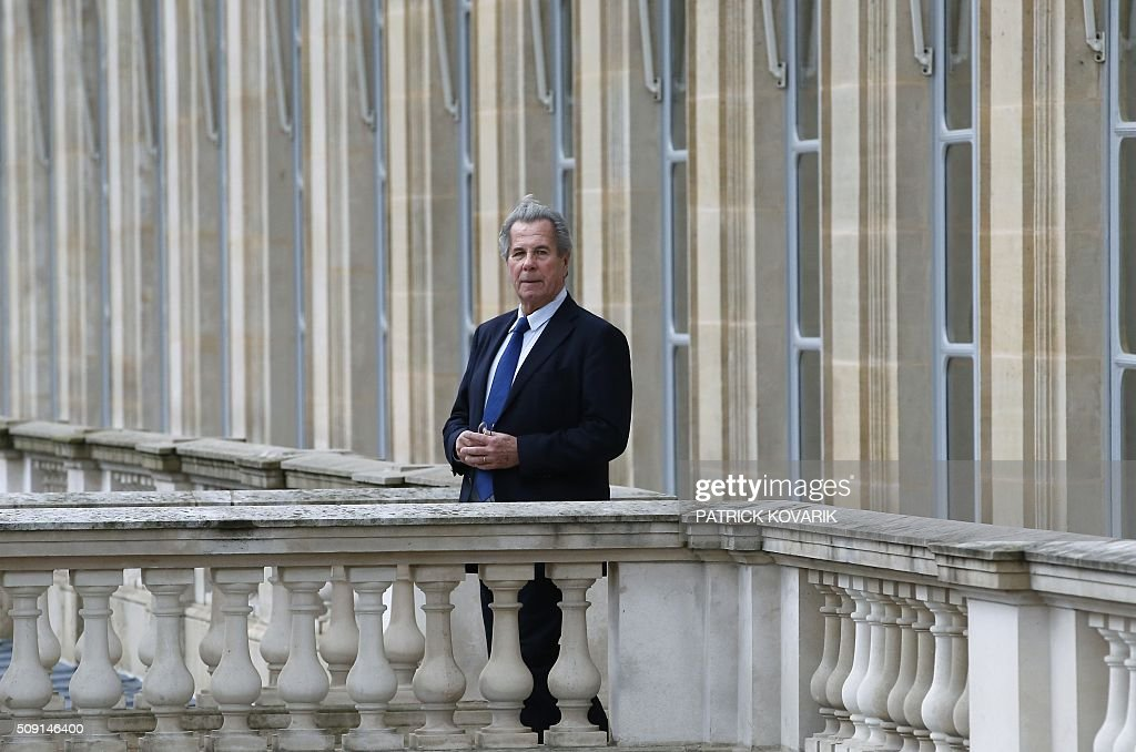 President of the Constitutional Council Jean-Louis Debré poses for a photograph at the Constitutional Council located in the Palais Royal in central Paris, on February 9, 2016, a few weeks before his departure. / AFP / PATRICK KOVARIK