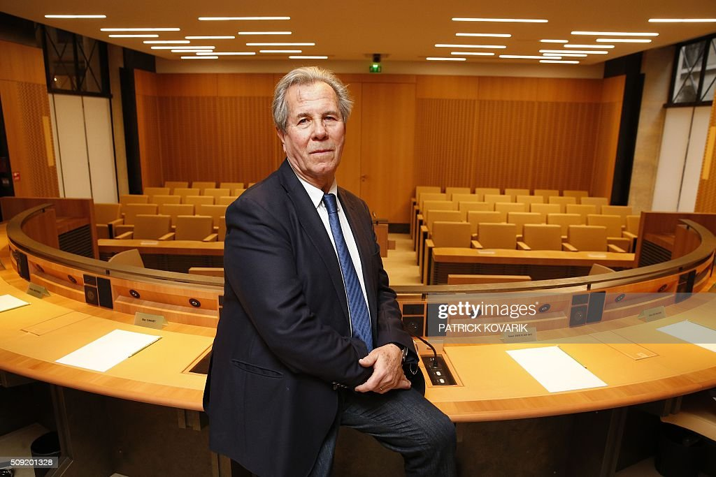 President of the Constitutional Council Jean-Louis Debré poses for a photograph in the Council chambers of the Constitutional Council located in the Palais Royal in central Paris, on February 9, 2016. / AFP / PATRICK KOVARIK
