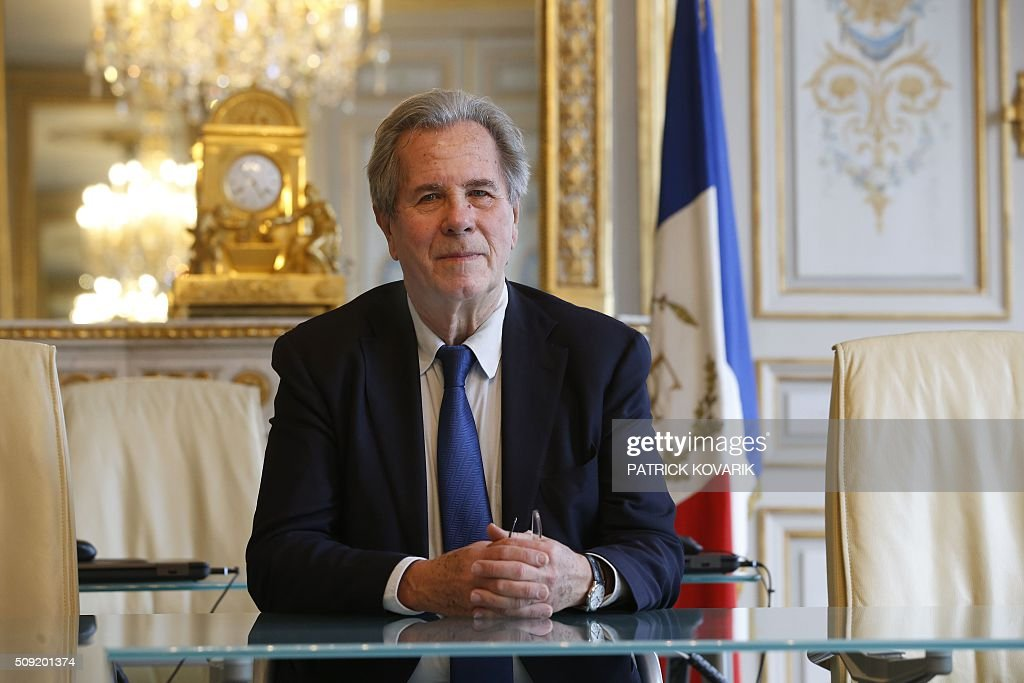 President of the Constitutional Council Jean-Louis Debré poses for a photograph in the Council chambers of the Constitutional Council located in the Palais Royal in central Paris, on February 9, 2016 a few weeks before his departure. / AFP / PATRICK KOVARIK