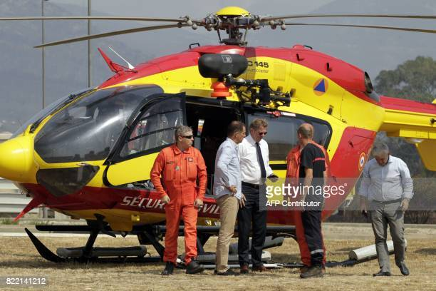 President of the Corsican executive council Gilles Simeoni and Haute Corse prefect Gerard Gavory speak with helicoptere pilot after flying over the...