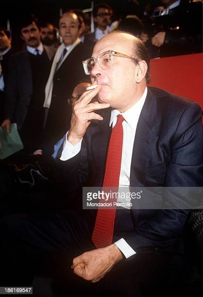 President of the Council of Ministers of the Italian Republic and Secretary of the Italian Socialist Party Bettino Craxi smoking a cigarette 1980s