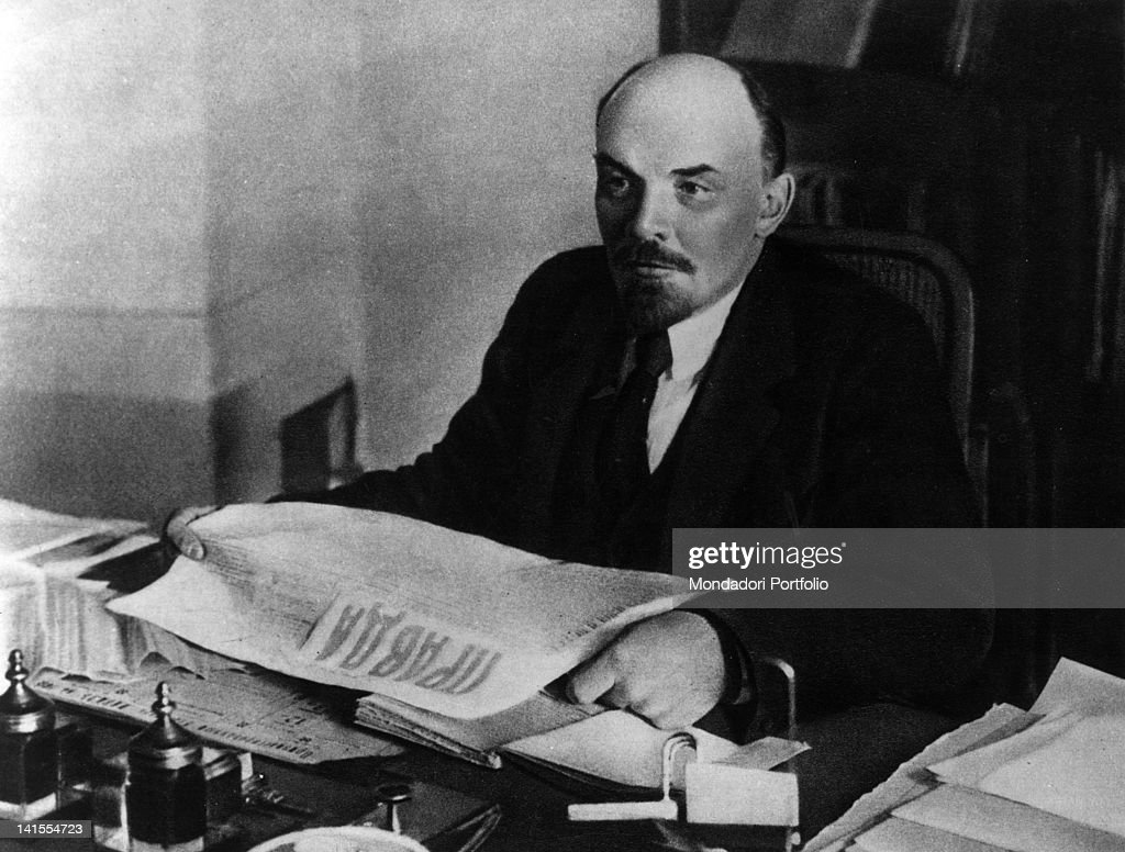 President of the Council of People's Commissars of the USSR <a gi-track='captionPersonalityLinkClicked' href=/galleries/search?phrase=Lenin&family=editorial&specificpeople=77725 ng-click='$event.stopPropagation()'>Lenin</a> reading a copy of 'Pravda' sitting at his desk. USSR, 1910s