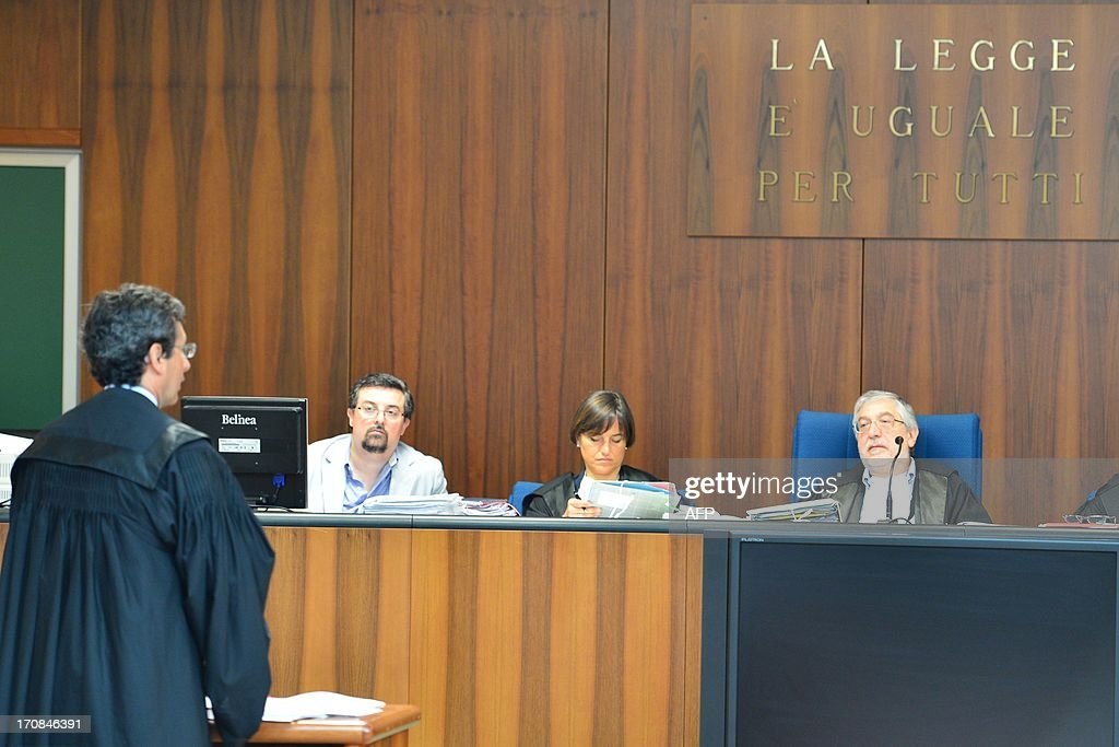 President of the courtroom Toni Adet Novik (R) listens to Prosecutor Eugenio Fusco during the trial to Giuseppe Orsi former head of the Italian aerospace and defense giant Finmeccanica on June 19, 2013 at the courtroom in Busto Arsizio near Varese. The former head of Finmeccanica goes on trial in a case involving alleged bribes to win a 560 Mio euro helicopter contract in India.