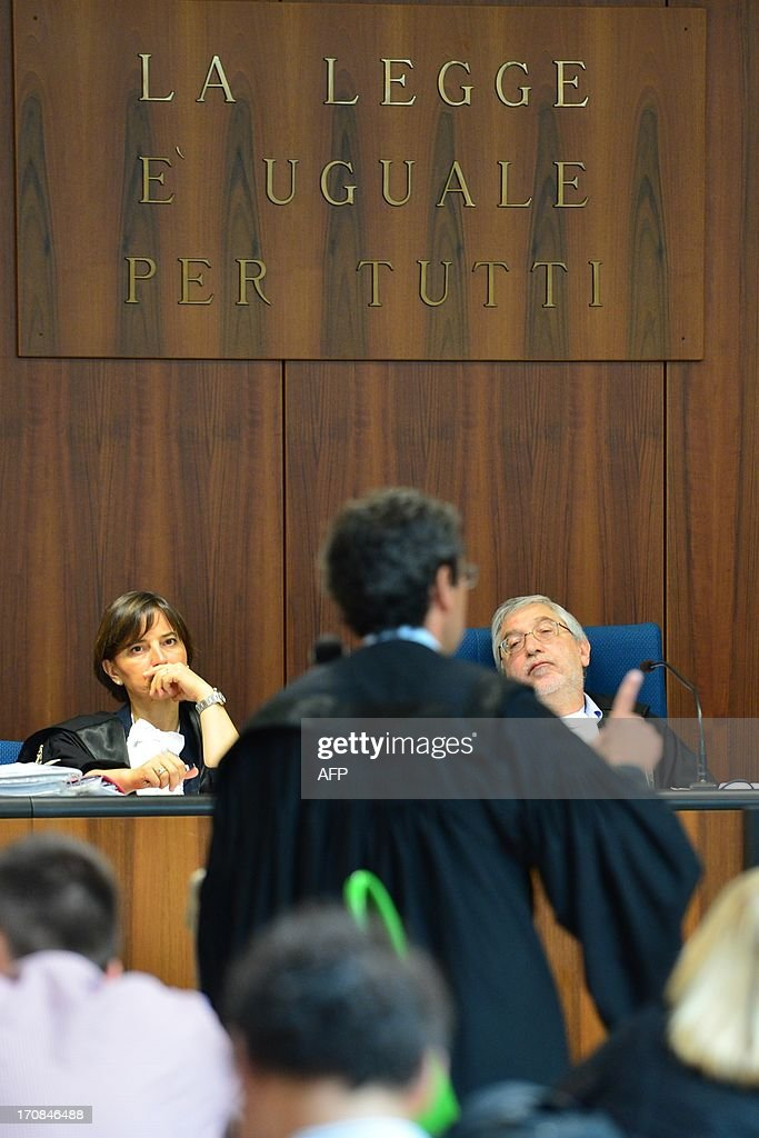 President of the courtroom Toni Adet Novik (C) listens to Prosecutor Eugenio Fusco during the trial to Giuseppe Orsi former head of the Italian aerospace and defense giant Finmeccanica on June 19, 2013 at the courtroom in Busto Arsizio near Varese. The former head of Finmeccanica goes on trial in a case involving alleged bribes to win a 560 Mio euro helicopter contract in India. AFP PHOTO / GIUSEPPE CACACE