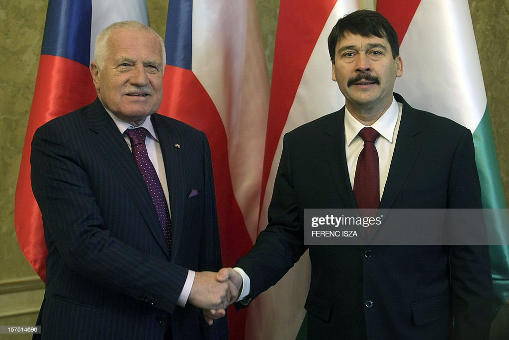 President of the Czech Republic Vaclav Klaus (L) and Hungarian President Janos Ader (R) shake hands prior to their bilateral meeting at the Presidental 'Sandor' Palace in Budapest on December 4, 2012. Klaus has two days visit to Hungary. AFP PHOTO / FERENC ISZA