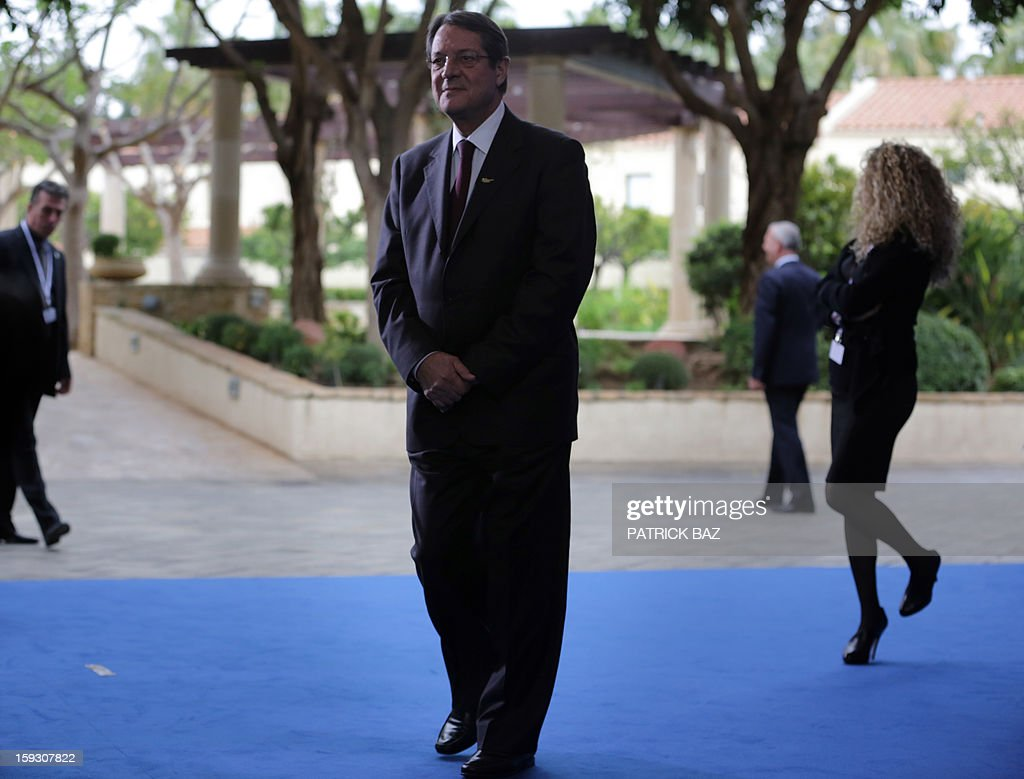 President of the Democratic Rally of Cyprus (DISY) and presidential candidate Nicos Anastasiades waits for his guests prior to the start of the extraordinary European People's Party (EPP) summit in Limassol on January 11, 2013, attended by EU heads of state, party leaders, and the presidency of the EPP. AFP PHOTO/PATRICK BAZ