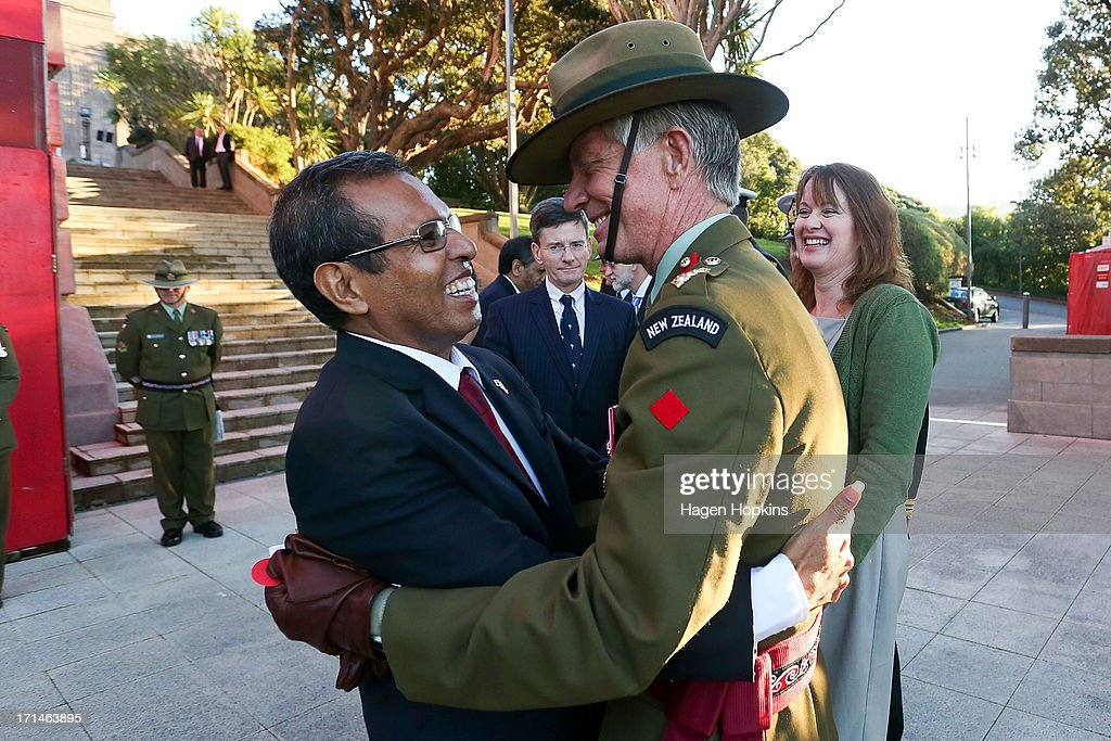 President of the Democratic Republic of Timor-Leste, Taur Matan Ruak embraces Martin Dransfield of the New Zealand Defence Force during a wreath laying ceremony at the National War Memorial on June 25, 2013 in Wellington, New Zealand. President Taur Matan Ruak of the Democratic Republic of Timor-Leste is in Wellington on an official visit until Thursday, June 27.