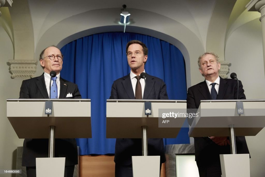 President of the Dutch Senate Fred de Graaf, Prime Minister Mark Rutte and mayor of Amsterdam Eberhard van der Laan give a press conference in The Hague, on March 26, 2013, on the upcoming abdication. Queen Beatrix announced on January 28, 2013 that she will give the throne to Crown Prince Willem-Alexander on April 30, 2013. AFP PHOTO/ANP/ MARTIJN BEEKMAN netherlands out