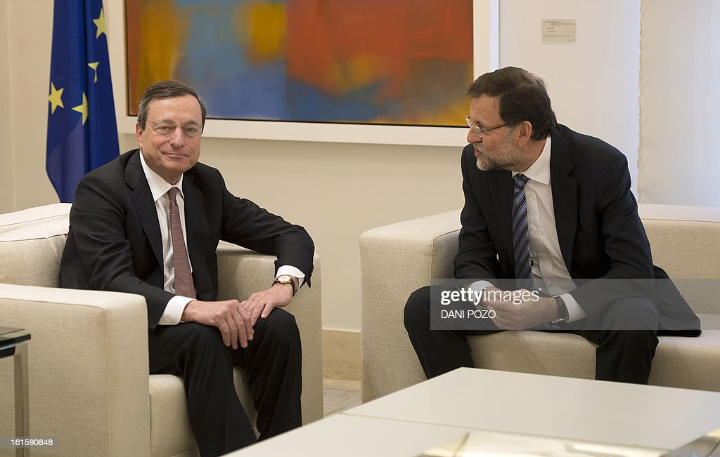 President of the ECB (European Central Bank) Mario Draghi (L) listens to Spain's Prime Minister Mariano Rajoy during a meeting at La Moncloa Palace in Madrid on February 12, 2013.