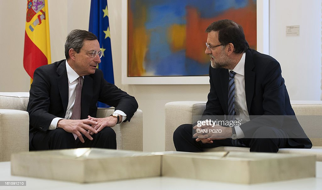 President of the ECB (European Central Bank) Mario Draghi (L) speaks to Spain's Prime Minister Mariano Rajoy during a meeting at La Moncloa Palace in Madrid on February 12, 2013.